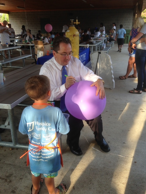 Ricky Rolin helps a friend write a special message on his balloon
