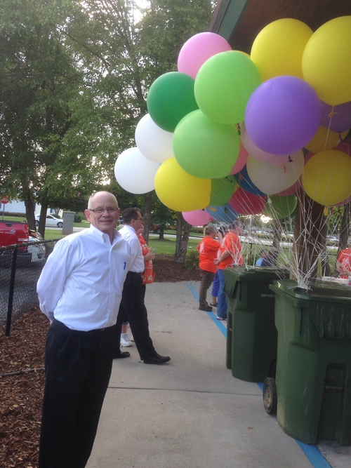 Steve Hannah waits to hand out balloons for the release